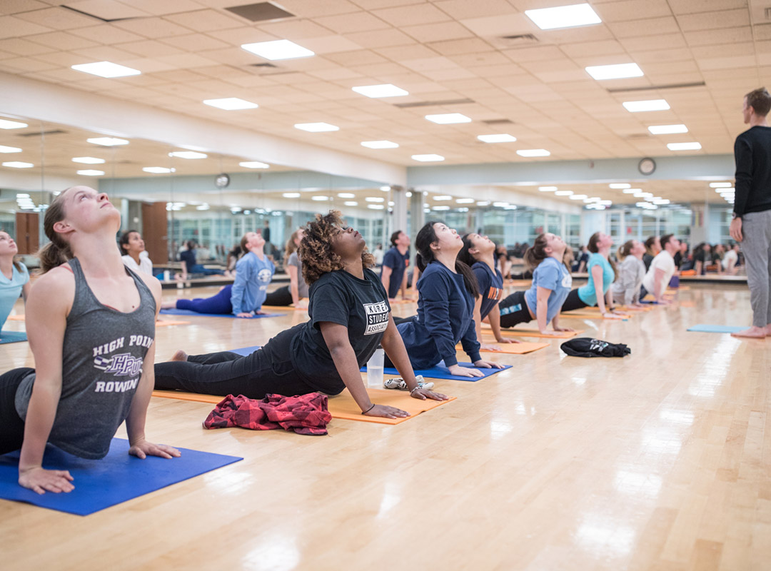 Students participate in a yoga class as an act of self-care
