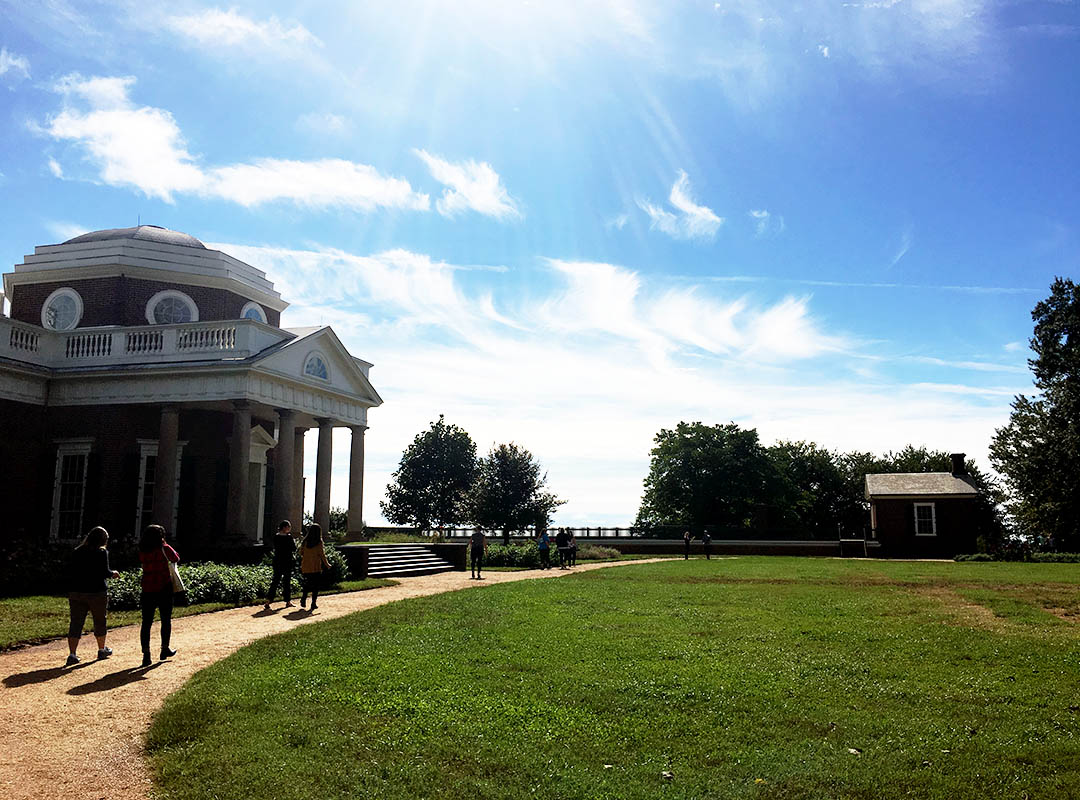 Staff members walking on path to South Wing at Monticello