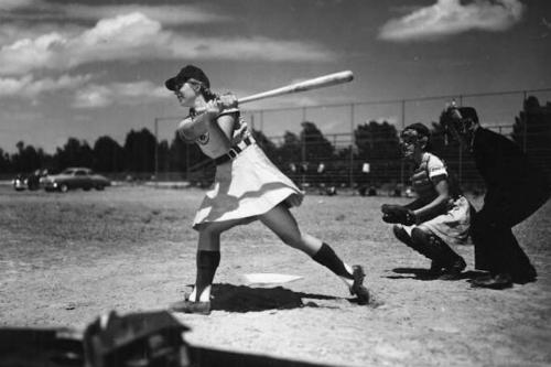Girls League Baseball Player Hitting