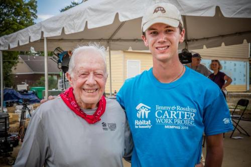 Student Taylor Thompson with former President Jimmy Carter at Habitat Site