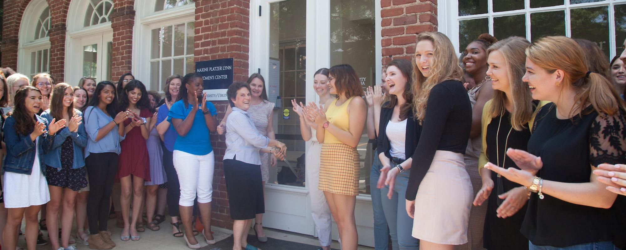 ribbon cutting in front of womens center